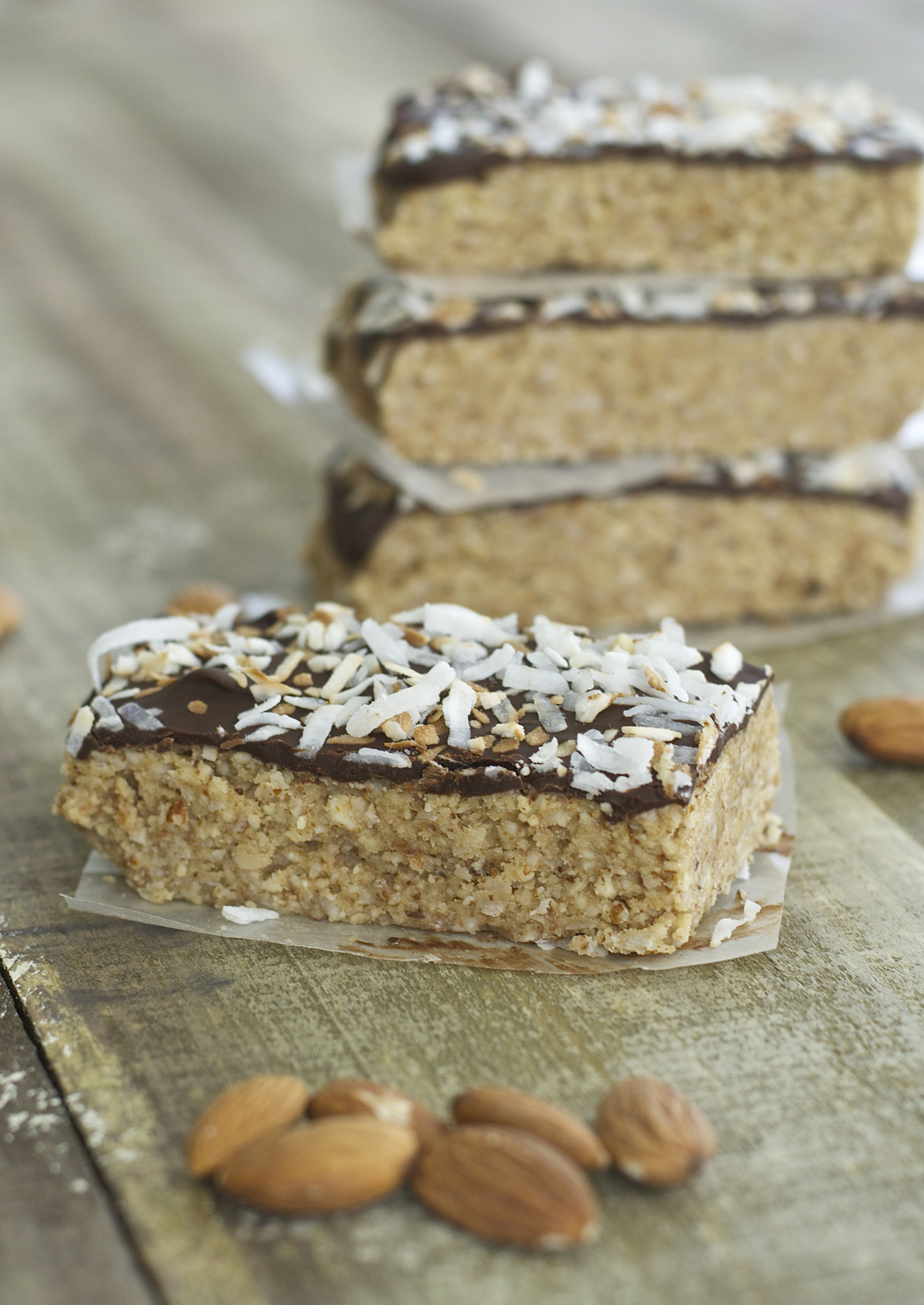These five ingredient No Bake Toasted Coconut and Almond Granola Bars are super simple to make! These gluten free, paleo friendly snacks will be your new favorite!