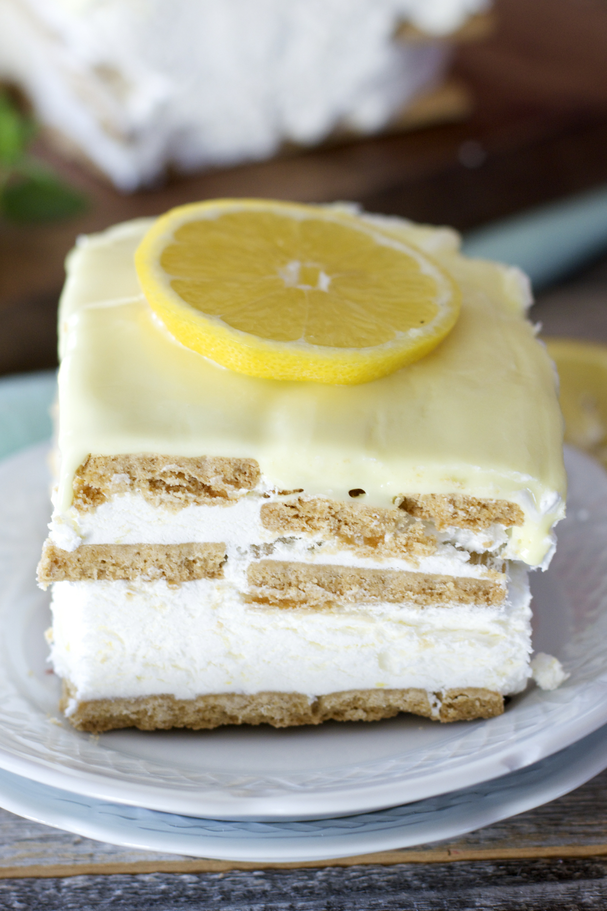 A slice of lemon icebox cake on a dessert plate.