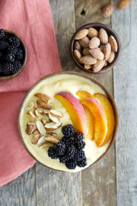Sweet peaches, almond milk and a touch of vanilla and honey are blended until smooth and topped with crunchy granola for a hearty healthy breakfast! This easy Peach Smoothie Bowl will be a new favorite!