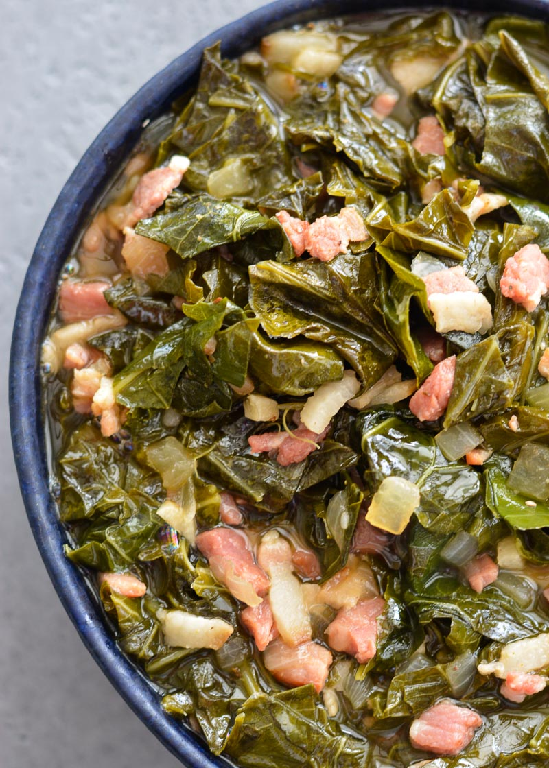 The BEST Instant Pot Collard Greens loaded with bacon, ham and perfectly tender! This will be your new favorite side dish recipe!
