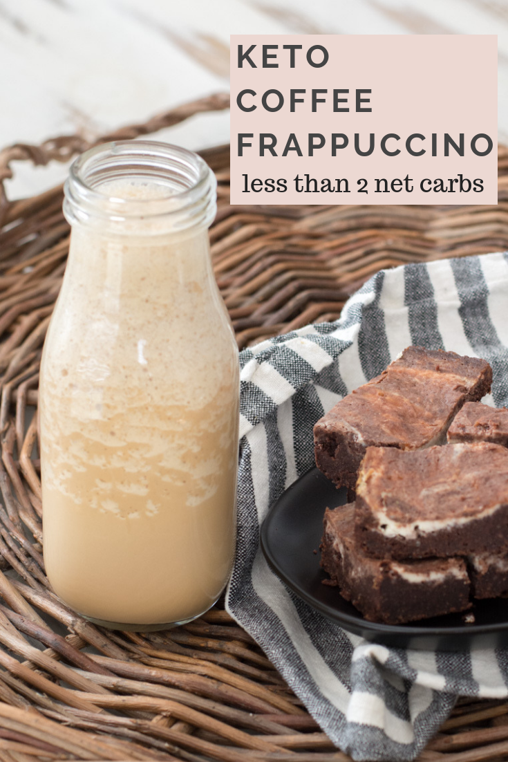 A copycat starbucks coffee frappuccino in a glass milk bottle next to a plate of brownies