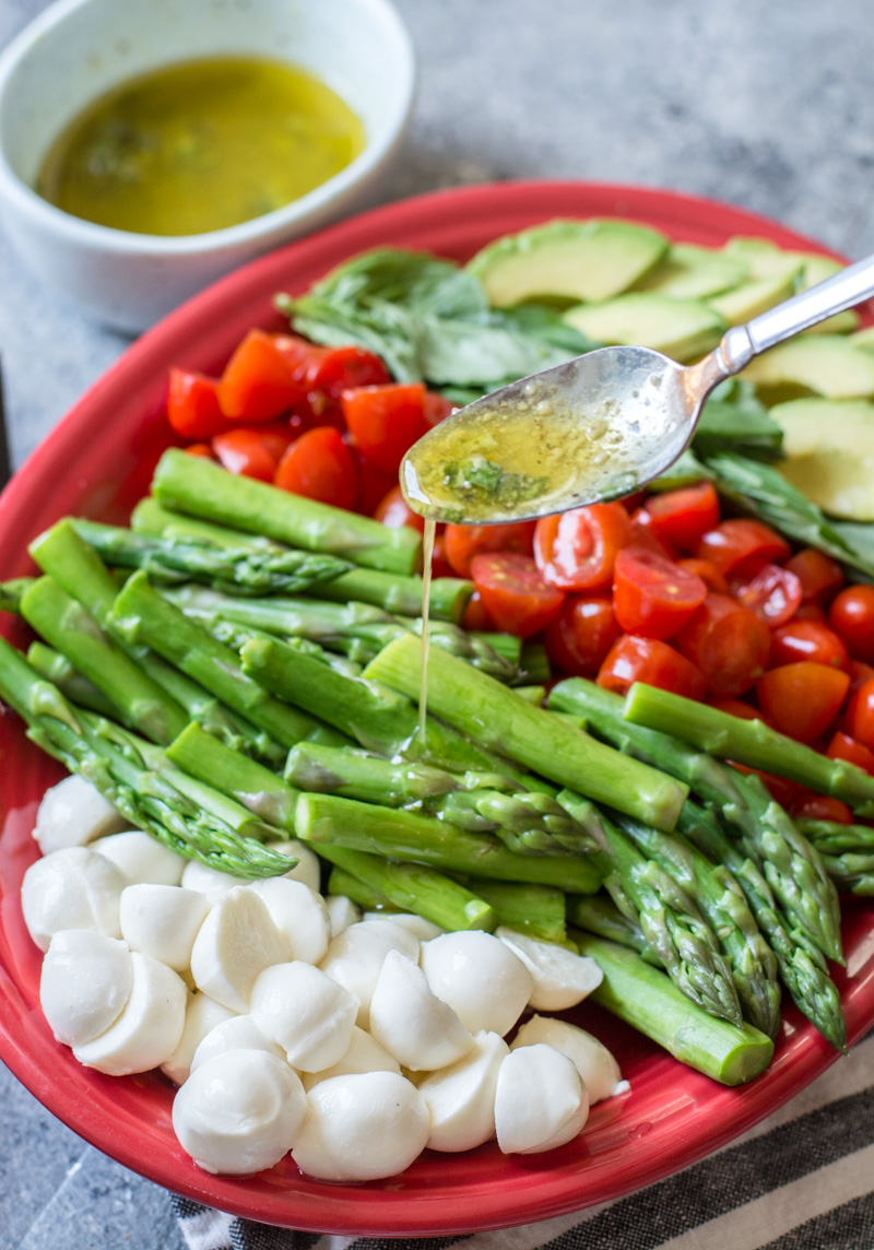 Asparagus, Tomato and Avocado Salad in a creamy lemon vinaigrette! Healthy, quick and delicious! The perfect low carb summer salad!