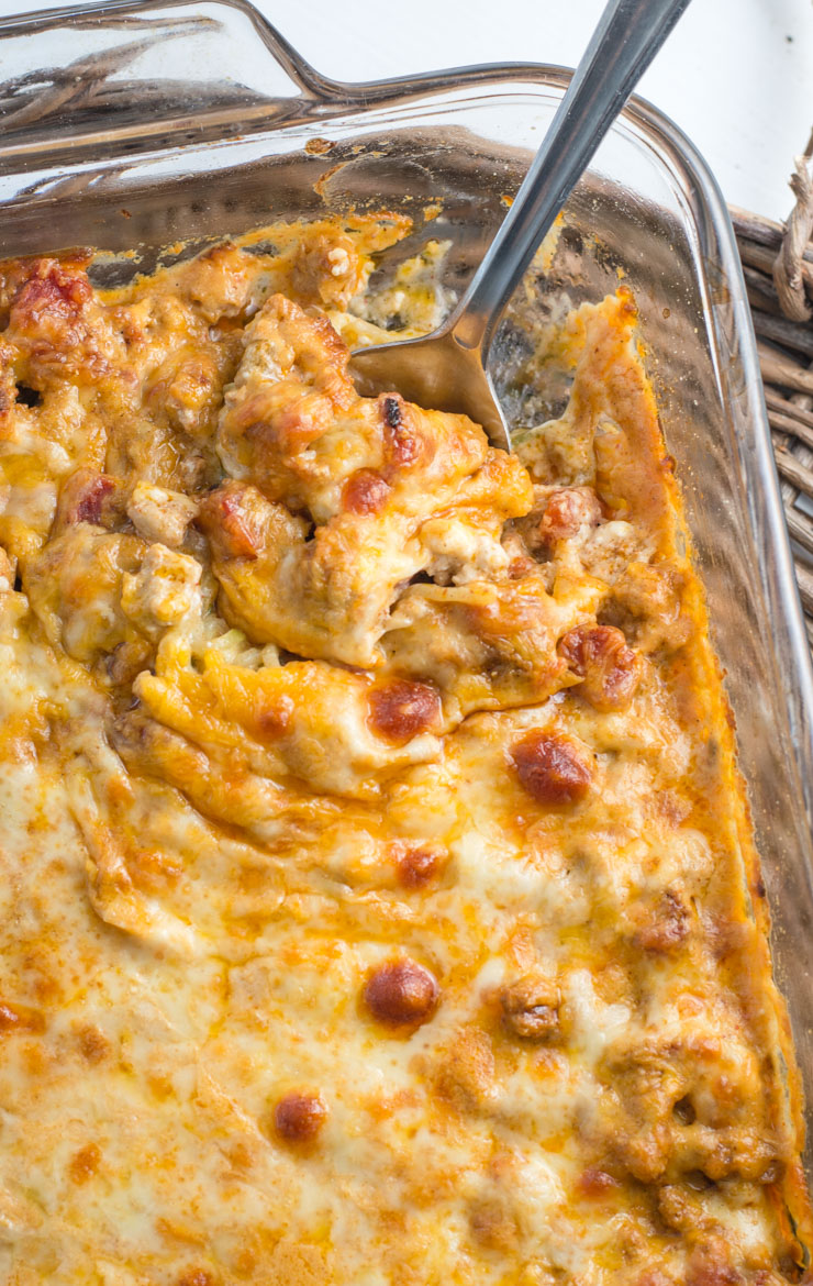 low carb taco casserole in a baking dish, seen from above. a spoon pokes out from the dish.