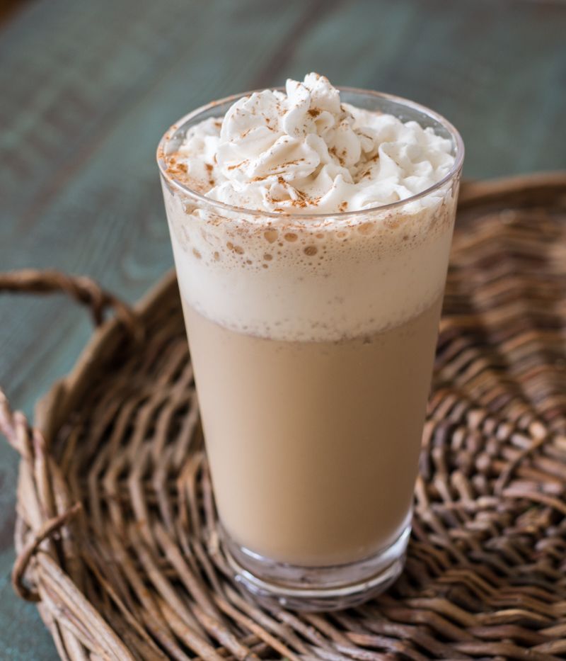 A keto frappuccino topped with whipped cream and cinnamon