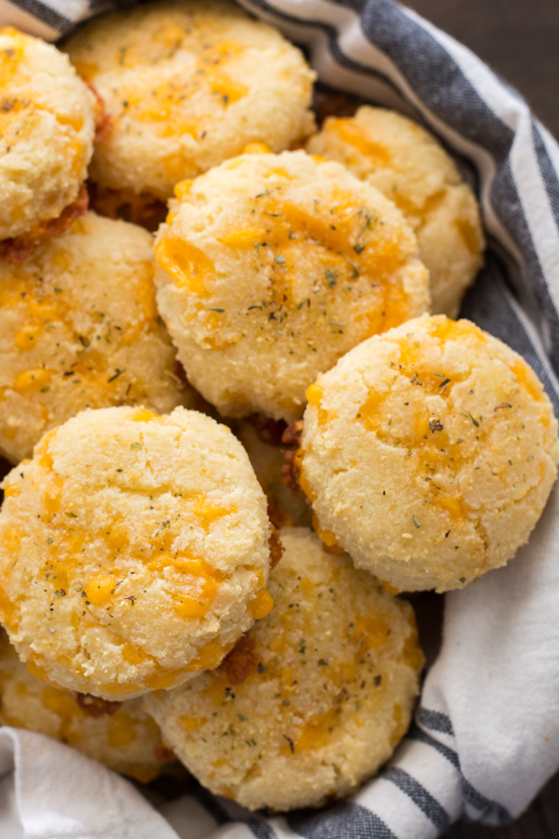a basket of cheddar keto biscuits