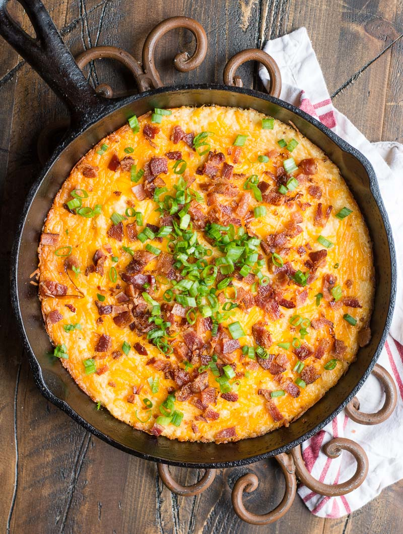overhead view of keto loaded cauliflower casserole in a cast iron skillet