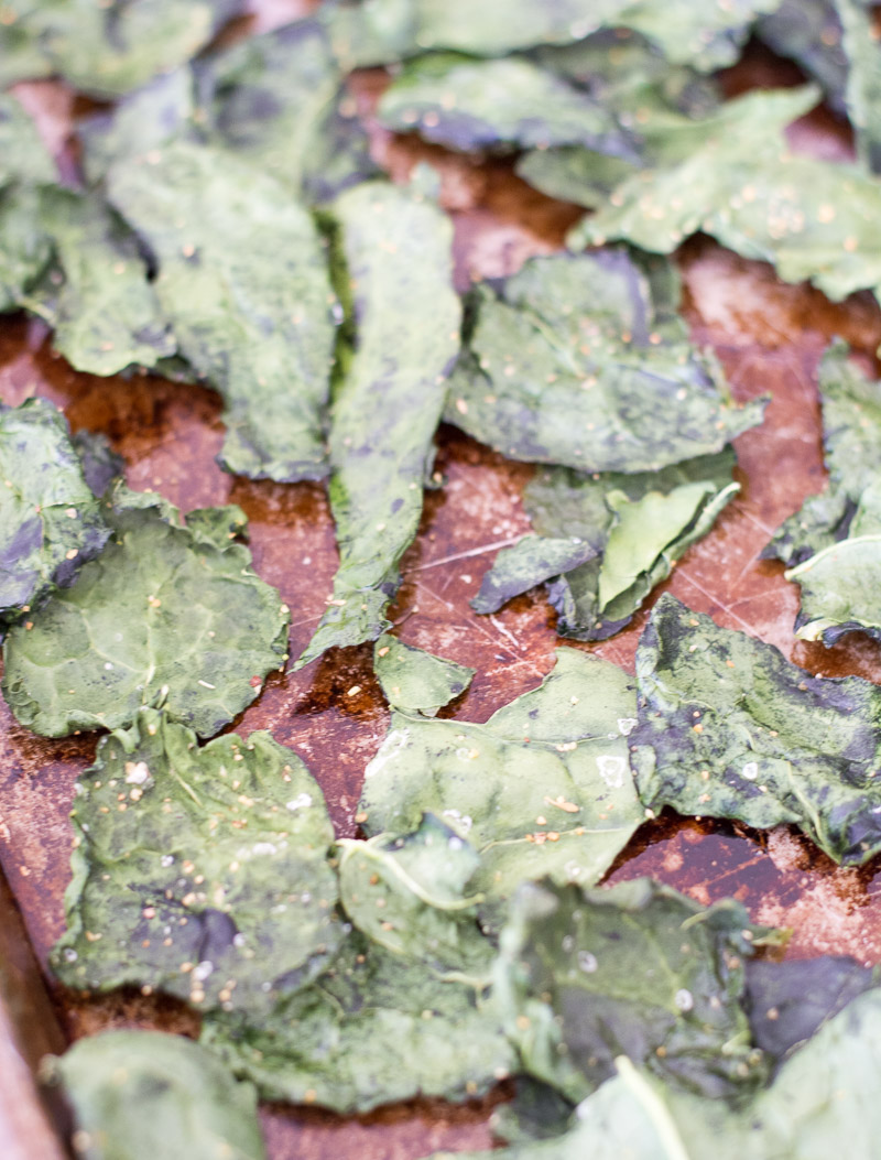 oven baked kale chips on a baking sheet
