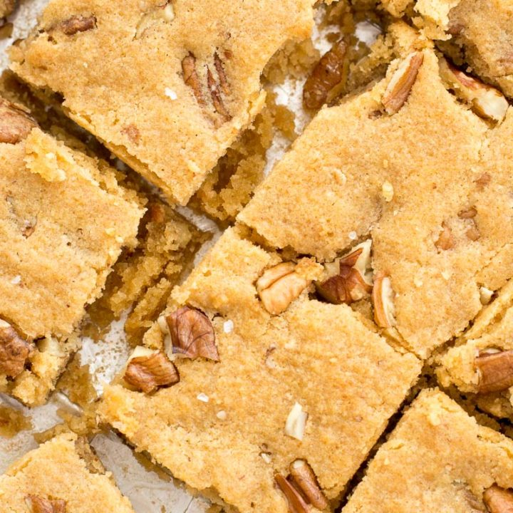 These Keto Butter Pecan Blondies are loaded with rich butter, vanilla and pecans! This is the perfect low carb dessert at about 2.5 net carbs per slice!  #keto