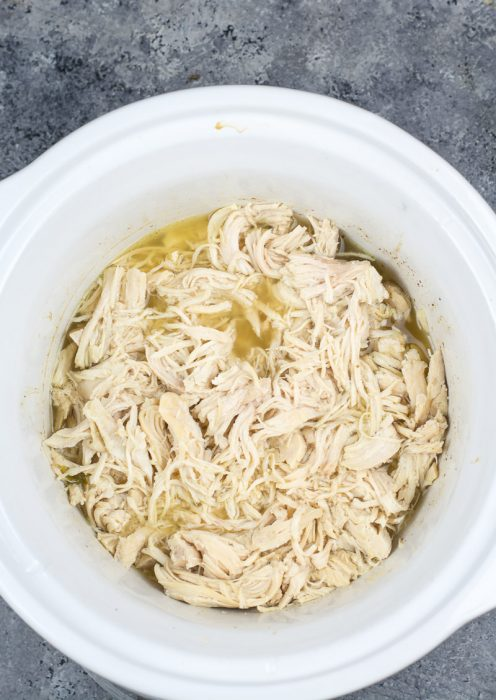This easy, all purpose Slow Cooker Shredded Chicken only requires a few ingredients and makes the best shredded chicken! Perfect for meal prep, casseroles, wraps and more!