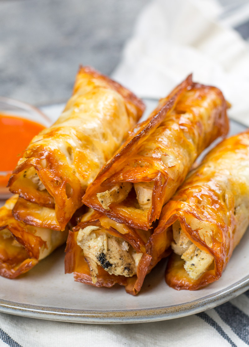 A stack of keto chicken taquitos on a plate.