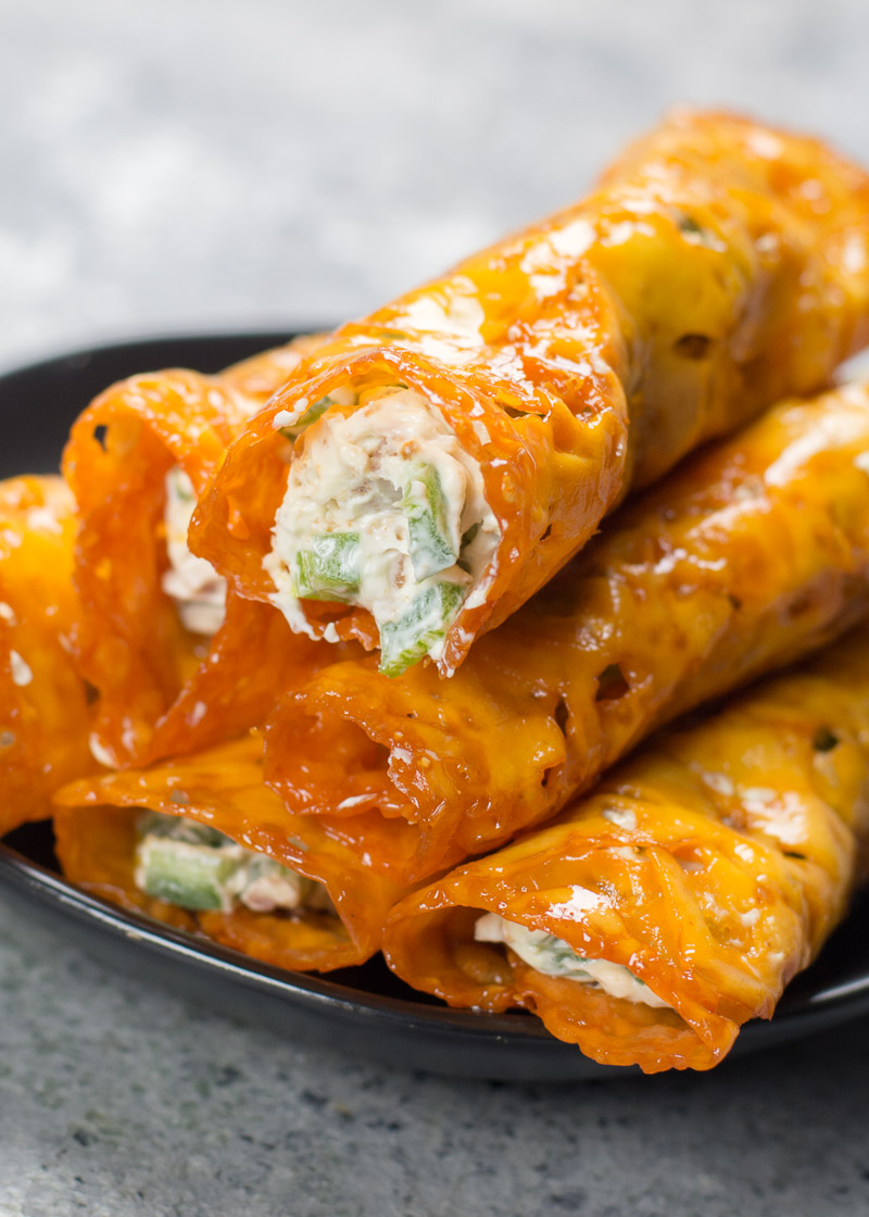 a pile of Jalapeño Popper Keto Taquitos on a gray plate