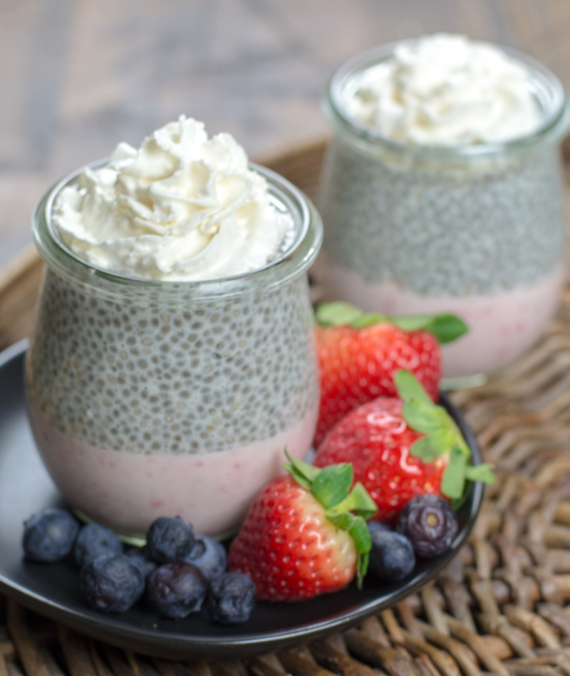 This decadent Keto Strawberry Cheesecake Parfaits feature a creamy strawberry cheesecake layer topped with vanilla chia seed pudding! A sweet keto treat under 5 net carbs!