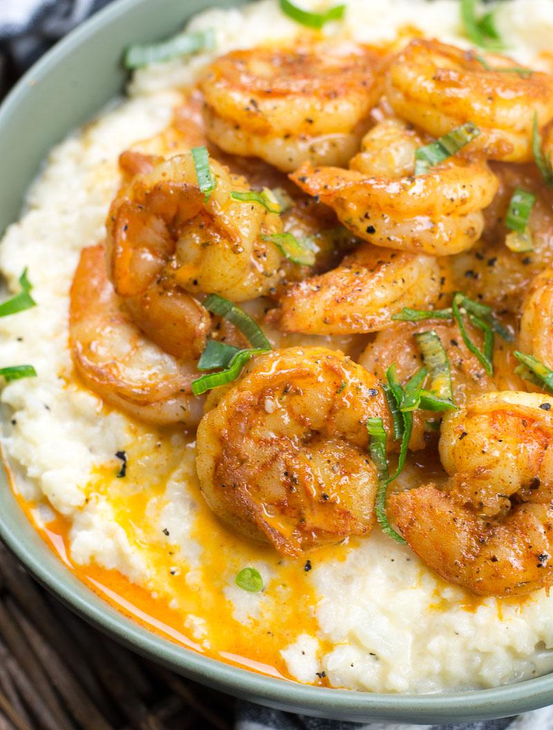 close up of keto shrimp atop cauliflower grits