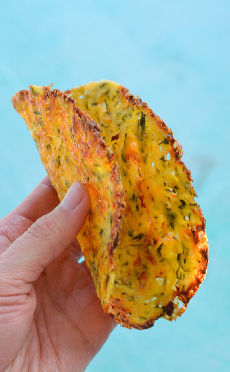 a keto friendly tortilla being held aloft