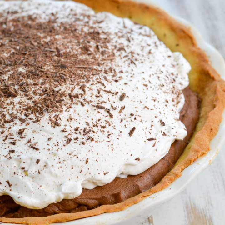 Try this Keto French Silk Pie for a decadent low carb dessert! At about 5 net carbs per slice this rich chocolate pie is an instant keto classic!
