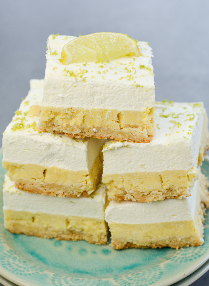 These delightful Keto Key Lime Bars feature a shortbread cookie crust, tangy lime bar layer topped with creamy lime whipped cream! At about 3 net carbs per bar this is a sweet treat that fits within your keto diet!