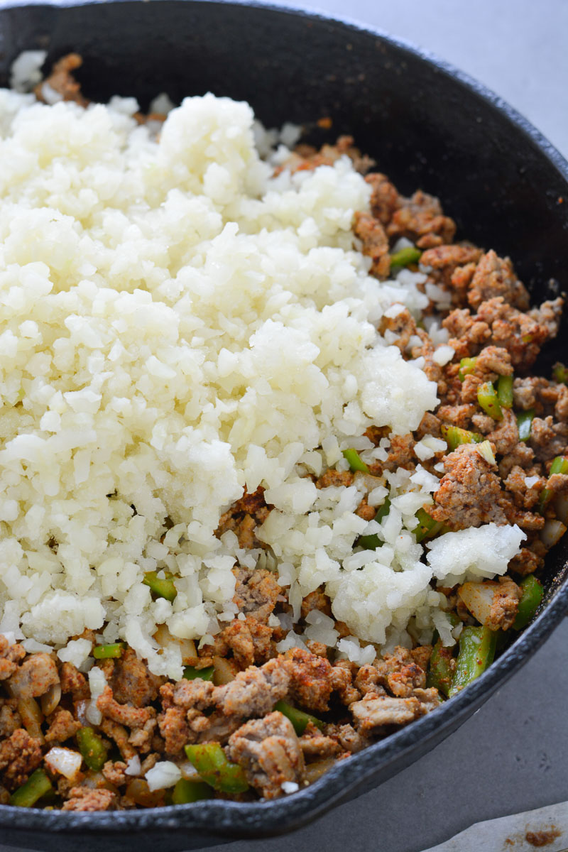This Easy Keto Taco Skillet is packed with taco meat, cauliflower rice, vegetables and cheese. This is perfect for keto lunch meal prep or a quick and easy dinner around 6 net carbs per serving!