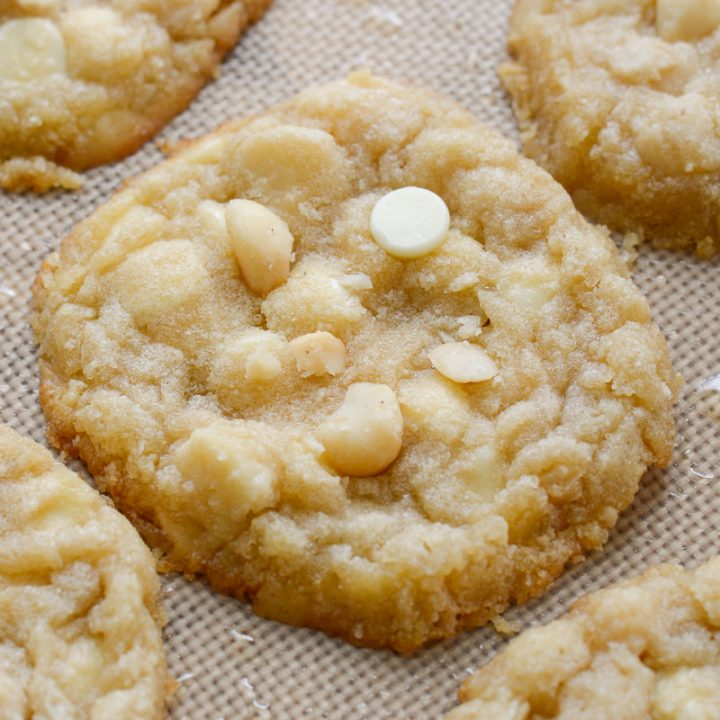 These Keto White Chocolate Macadamia Nut Cookies are the perfect low carb dessert! Each cookie is packed with sweet white chocolate chips and salty macadamia nuts for about 3 net carbs each!