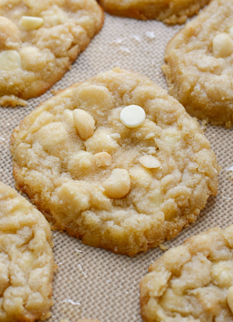 close up of keto white chocolate chip macadamia nut cookies on a baking sheet
