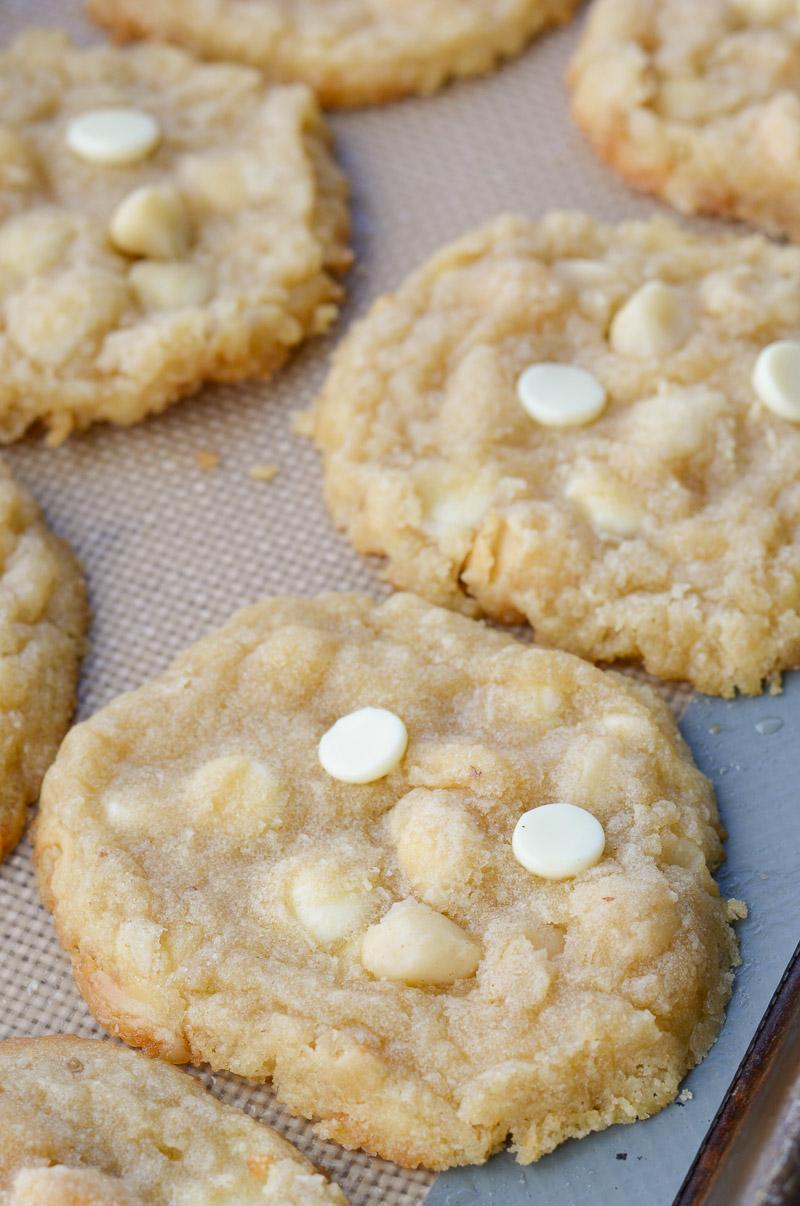 keto white chocolate macadamia nut cookies on a baking sheet