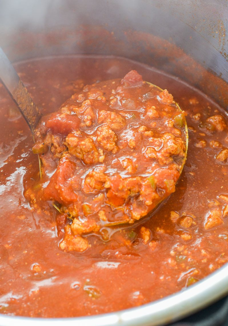 Close up of a ladle full of no bean chili in an Instant Pot.