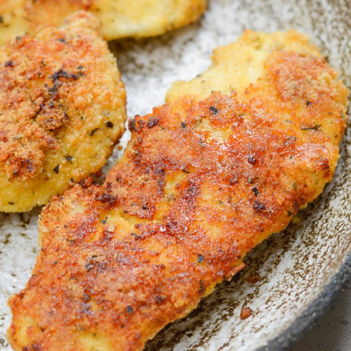 These Easy Keto Chicken Tenders can be made in the air fryer or oven and contain about 2 net carbs per serving!