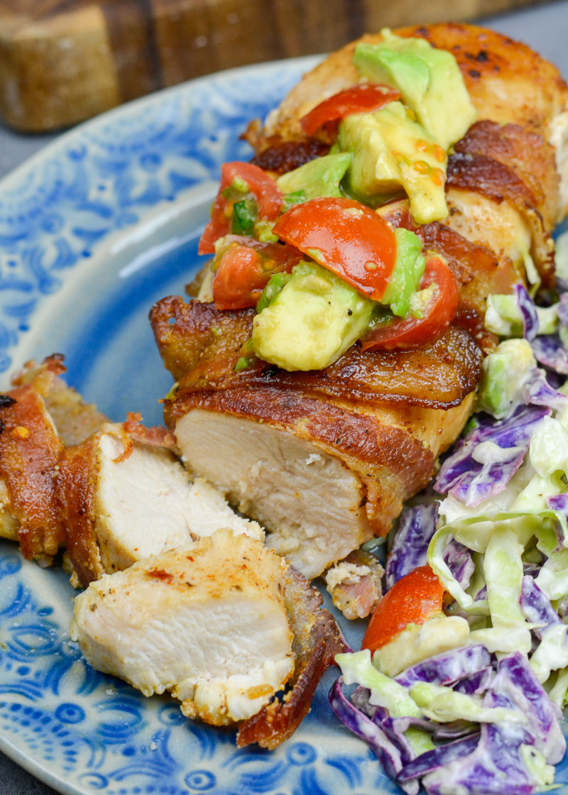 Enjoy Bacon Wrapped Chicken with Avocado Salsa for an easy weeknight meal! This low carb dish contains just 3 net carbs per serving and is ready in under 30 minutes!