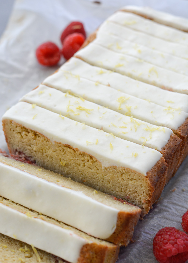 Enjoy a slice of Keto Lemon Raspberry Bread topped with Lemon Cream Cheese Glaze for under 3 net carbs per slice!