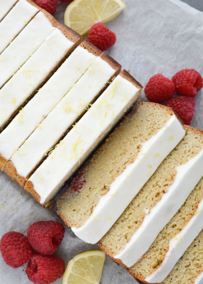 Enjoy a slice of Keto Lemon Raspberry Bread topped with Lemon Cream Cheese Glaze for under 3 net carbs per slice!