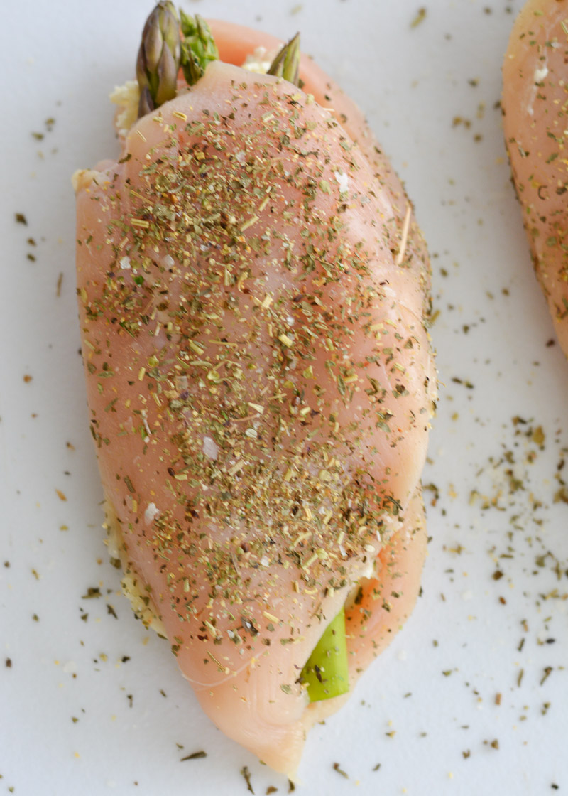 This Asparagus Stuffed Chicken is loaded with two kinds of cheese, tender asparagus and is rubbed with an Italian herb mix. This one pan, low carb recipe has about 2 net carbs per serving and is ready in 30 minutes.