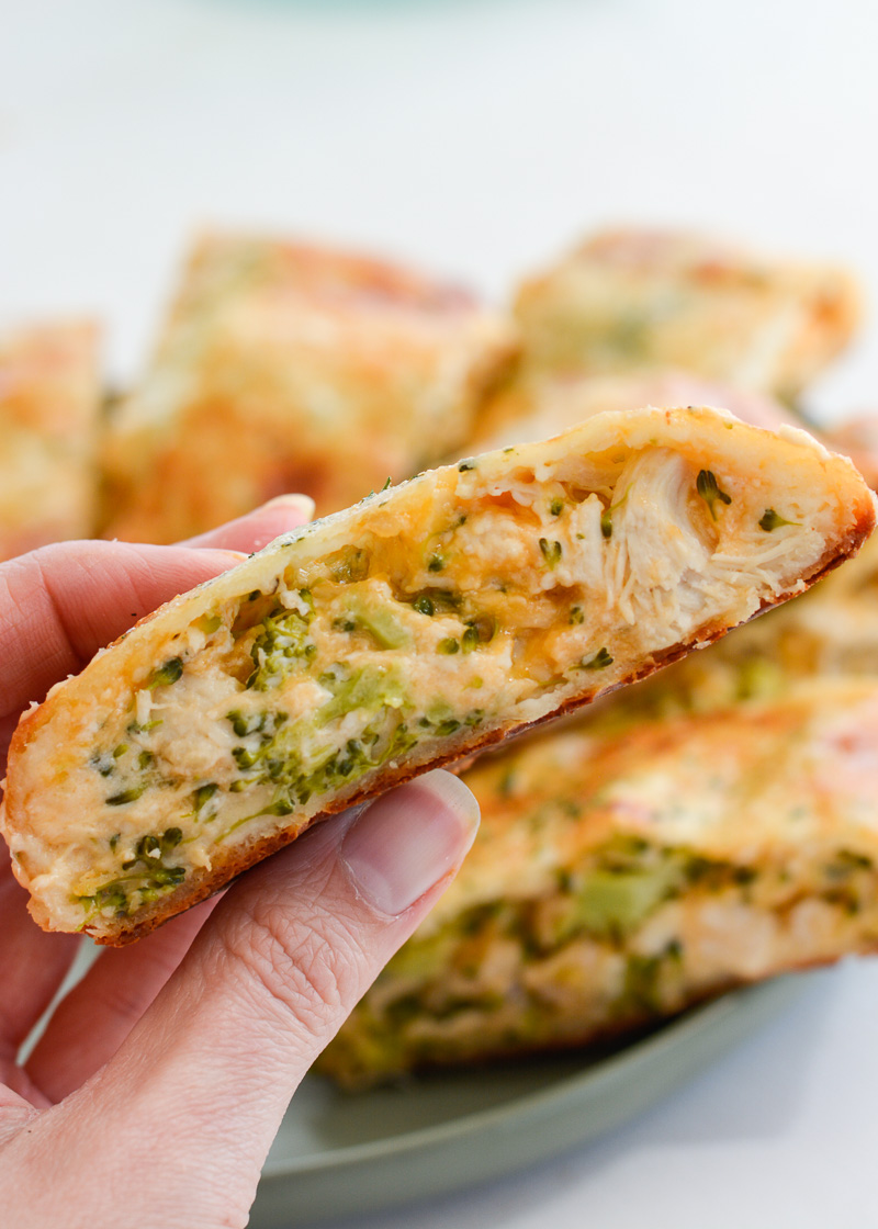 This Chicken Broccoli Cheddar Hot Pocket is loaded with tender chicken, fresh broccoli and loads of cheese wrapped in a perfectly soft and fluffy crust! Each slice is about 3 net carbs!