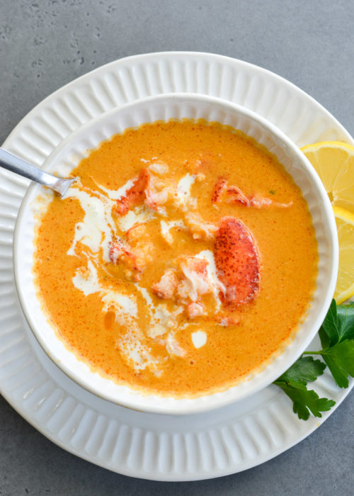 This creamy Lobster Bisque is a shortcut recipe that is low on carbs, but big on flavor! This 30 minute soup recipe features a savory broth and garlic butter lobster for a truly decadent meal!
