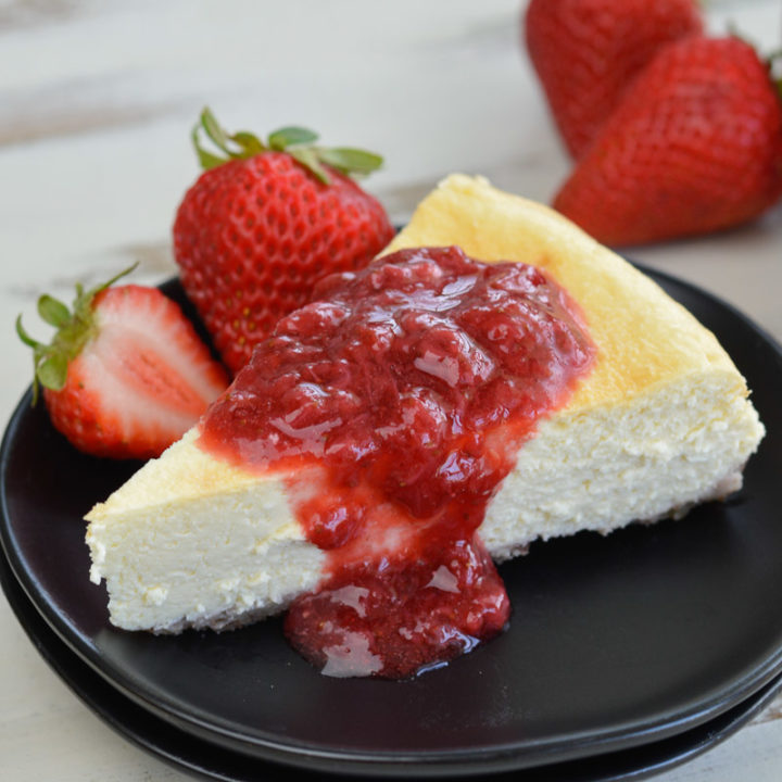 This Keto Cheesecake with Strawberry Sauce is the perfect low-carb treat to enjoy fresh berries this summer!