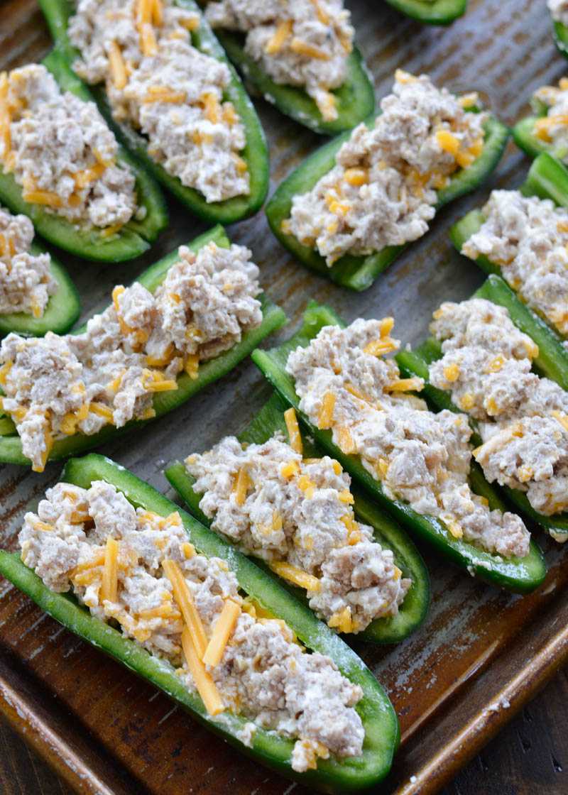 Keto Sausage Stuffed Jalapeno Poppers are the ultimate low carb appetizer! Each generous serving size has less than 3 net carbs!