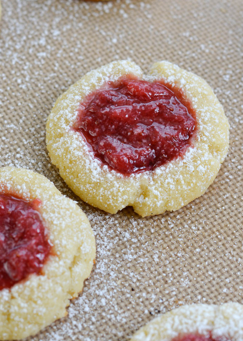 Keto Strawberry Thumbprint Cookies are the perfect sweet treat for about 2 net carbs each! Low carb sugar cookies are packed with fresh strawberry sauce and baked until soft and chewy!