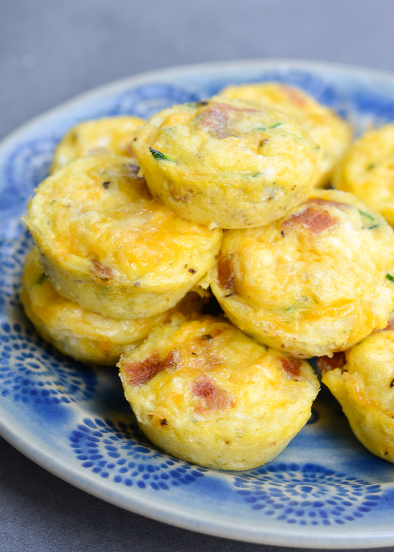 These savory Bacon Egg and Zucchini Bites are loaded with fresh veggies, salty bacon and tons of each! Each mini muffin has just 0.2 net carbs each making them an amazing keto breakfast option!