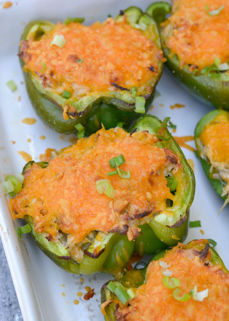 These six ingredient Green Chile Chicken Stuffed Peppers have under 5 net carbs per serving! Packed with chicken, cheese and spices, this is an easy dinner your entire family will love!