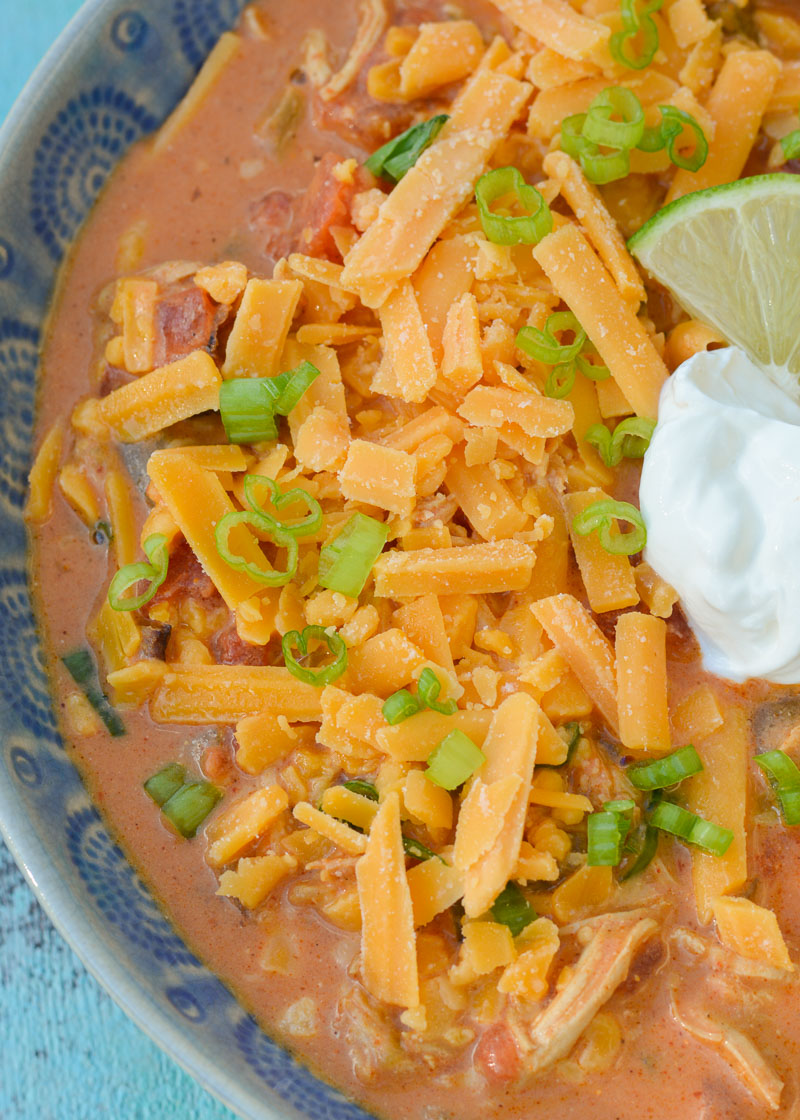 This Keto Cheesy Chicken Enchilada Soup is perfect topped with more shredded cheese, green onions, sour cream, and lime!