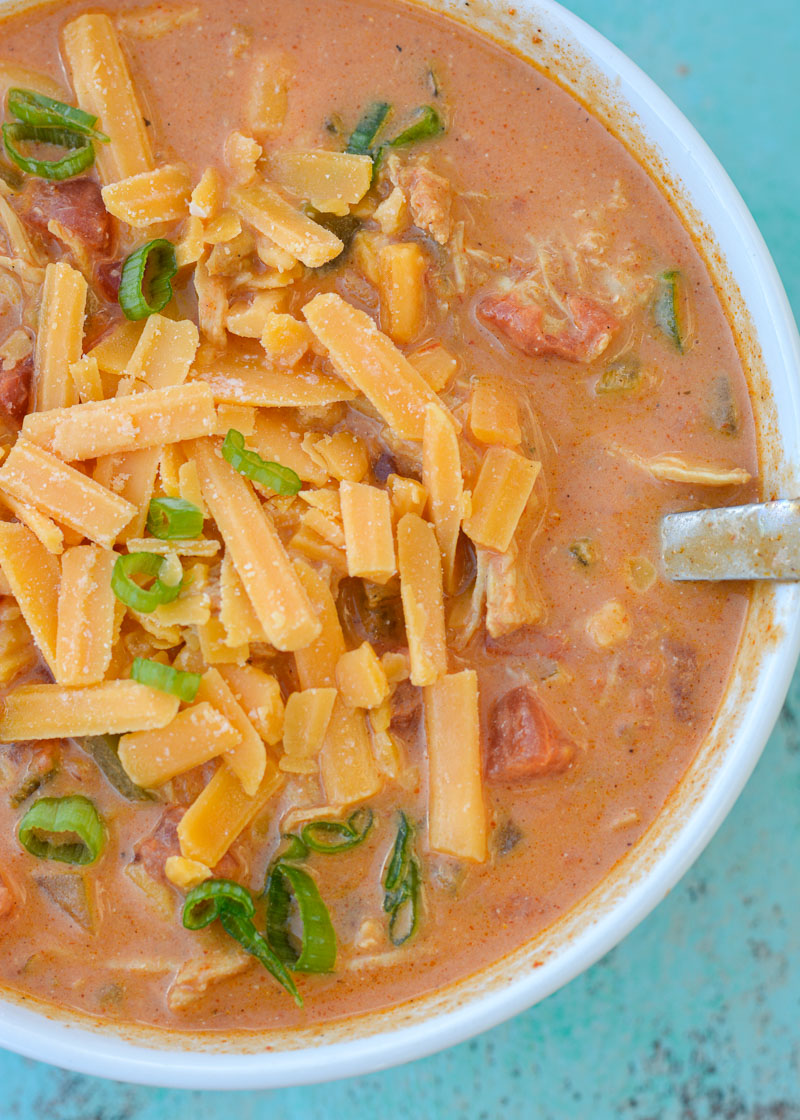 Let this Keto Cheesy Chicken Enchilada Soup cook all day in the slow cooker for an easy, low-carb dump meal!